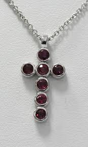 ruby cross pendant set in 14k white gold