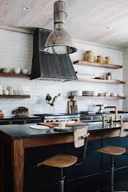 vintage wolf stove. industrial kitchen island with vintage architect stools - transitional wolf stove o