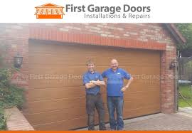 first garage doors father and son working together