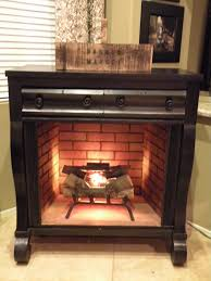 old dresser turned fireplace mantel not crazy about this one but it s an intriguing concept