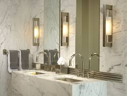 modern bathroom with square wall sconces and vessel sink
