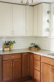upper cabinet lighting. two tone kitchen reveal white upper cabinets darker wood base lowers and subway cabinet lighting o