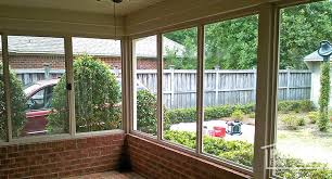 porch enclosure with existing brick knee wall and foundation interior