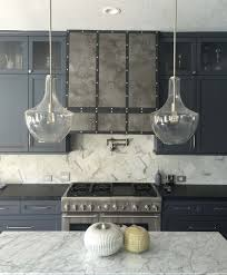 Marble slab backsplash Solid Slab Natural Stone Kitchen Backsplash And Countertop Soapstone And White Carrara Marble Designer Carla Carla Aston When To Use Natural Stone Backsplash And When Not To Designed