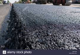 Freshly Laid Black Bitumen Asphalt With A High Edge To The