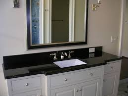 white bathroom cabinets with dark countertops. Single Sink Dark Countertop White Bathroom Cabinets Under Framed Mirror And Wallsconces In Painted Wall With Countertops R