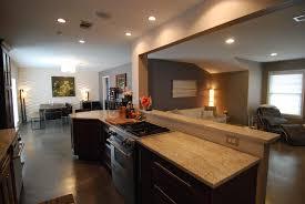 Open Floor Plan Living Room Decorating Dark Brown Floor Connected By Beige Granite Countertops And Some