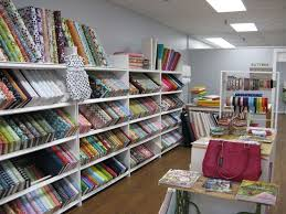 Stoffregale-fabric bolts | Black bookshelf, Display and Shopping & fabric store designer | South Carolina District Office | SBA.gov Adamdwight.com