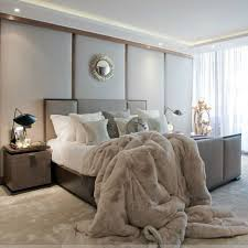 taupe bed, floor and a faux fur blanket for a cozy modern bedroom look
