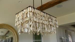 an oyster s chandelier in the dining area diy home decor throughout beach house