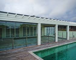 the retractable frameless sliding glass door system has been tried tested and proven to provide australians with a safe sleek structured wall of glass