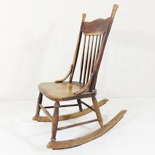Beautifully worn antique rocking chair. This style is known as a nursing  rocker as it