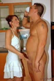 Elegant naked man and clothed woman