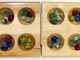 Game With Rocks And Wooden Board Simple How To Play Mancala