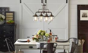 Dining room table lighting Lighting Fixtures Rustic Chandelier With Vintage Light Bulbs Over Table In Dining Room Lowes Chandeliers Pendant Lighting Inspiration