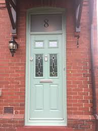 this is a chartwell green composite grp door including a fan light with house number etched in the glass above the door green on white interior