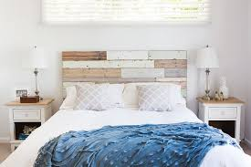 wood panel headboard becomes a key element in the shabby chic bedroom design the