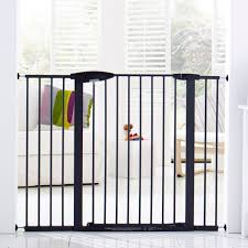 furniture munchkin baby gate with glass window and white sofa