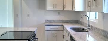 white cabinets with marble countertops gray cabinets white marble countertops