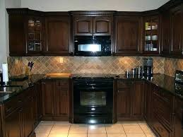 light brown cabinets with granite countertops brown kitchen cabinets with dark and lighter colored tile floors
