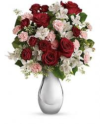 this wildly romantic bouquet is called crazy for you because that s what she will be when she sees it luscious red roses white alstroemeria and pink