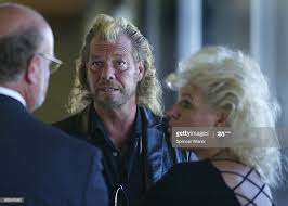 Bounty hunter Duane Lee Chapman , center, with his wife, Beth ...