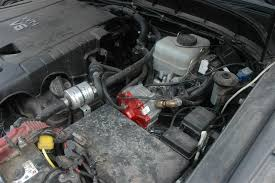 toyota fj cruiser lpg by stag gas in the mud s com toyota fj cruiser the lpg reducer next to the engine