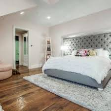 Girl's Bedroom Features Dramatic Tufted Headboard. An oversized ...