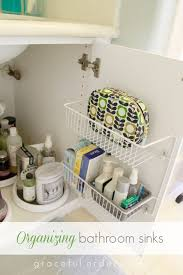 attach wire baskets to the backs of your cabinet doors to utilize unused space smart