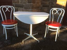 ice cream parlor table and red seat chairs front
