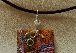 i used the book to create a bail for this front drilled pendant and added some embellishments to the bail