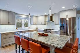 ivory kitchen cabinets. Gorgeous Kitchen Design Features Ivory Cabinets Flanking Modern Steel Hood, Linear Marble Tile