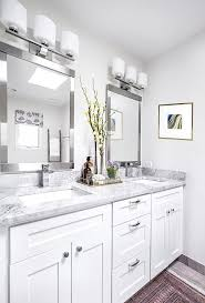 white bathroom lighting. a contemporary first home for growing family modern bathroom light fixturescontemporary mirrorsmodern white lighting