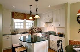 white small countertop island black chair black pendant lights under cabinet range hood slide in gas range wall mounted kitchen cabinet