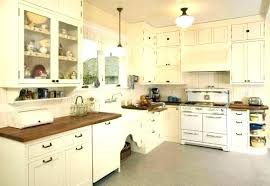 white kitchen with wood cabinets shabby chic dark countertops brown c