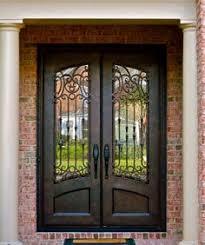 metal front doorsClark Hall Doors  Entry Doors  Hand Carved Wood and Wrought Iron
