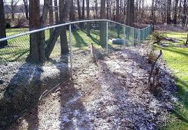 building a fence on uneven ground how to install a chain link fence on uneven ground