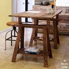 a bird s leap diy rustic desk with stained ikea legs this would make an awesome adjule cutting table