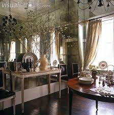 Neo-classical console table against a smokey mirrored wall.