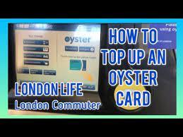 an oyster card using an oyster machine