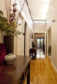 hotel hallway lighting. Interior, Long And Narrow Modern Hallway Design With Laminate Hardwood Floor Tiles Combined Dark Hotel Lighting