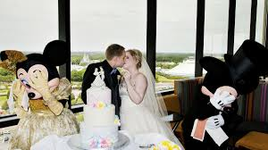 tom and maranda wulz with minnie and mickey mouse at their disney wedding reception photo david and vicki arndt weddings