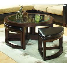 A small, circular side table fits underneath a large coffee table, so you can spread them out around the room for a cohesive look, or save space until company comes over. Round Coffee Table Ottomans Underneath Architecture Design Facebook