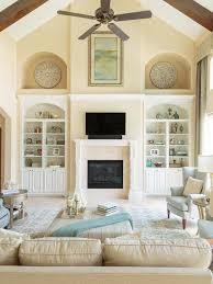 inspiration for a large timeless open concept travertine floor living room remodel in houston with yellow
