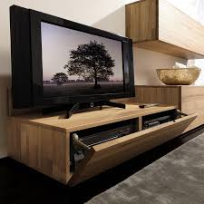 Tv Wall Unit Cubic Glass Panels On The Wall And Standing Cabinets Give The