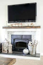 how to cover a fireplace learn how to cover your brick fireplace to transform it from dated to modern farmhouse style reface fireplace with stone veneer