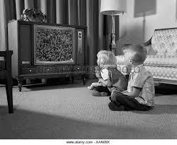 black kids watching tv. 1960s two children boy \u0026 girl sitting on floor watching television - stock image black kids watching tv e
