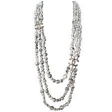 chanel necklace. chanel necklace - rare pearl graffiti triple strand cc logos black and white 1 1stdibs