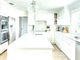 White cabinets with marble countertops Slate White New York Spaces Magazine White Kitchen With Carrera Marble Countertops White Copy Kitchen