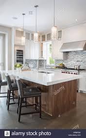 pendant lights over modern white kitchen island